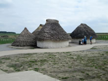 Neolithic house reconstructions at Stonehenge Visitor Centre.