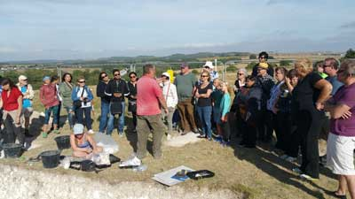 Salisbury & Stonehenge tour guests at Durrington Walls dig. 11th August 2016.