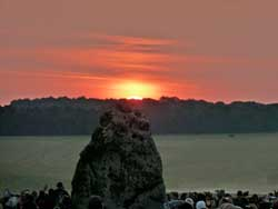 Summer solstice sunrise over the Heel Stone at Stonehenge.