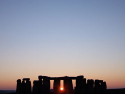 Winter solstice sunset from the walkway inside the monument field at Stonehenge.